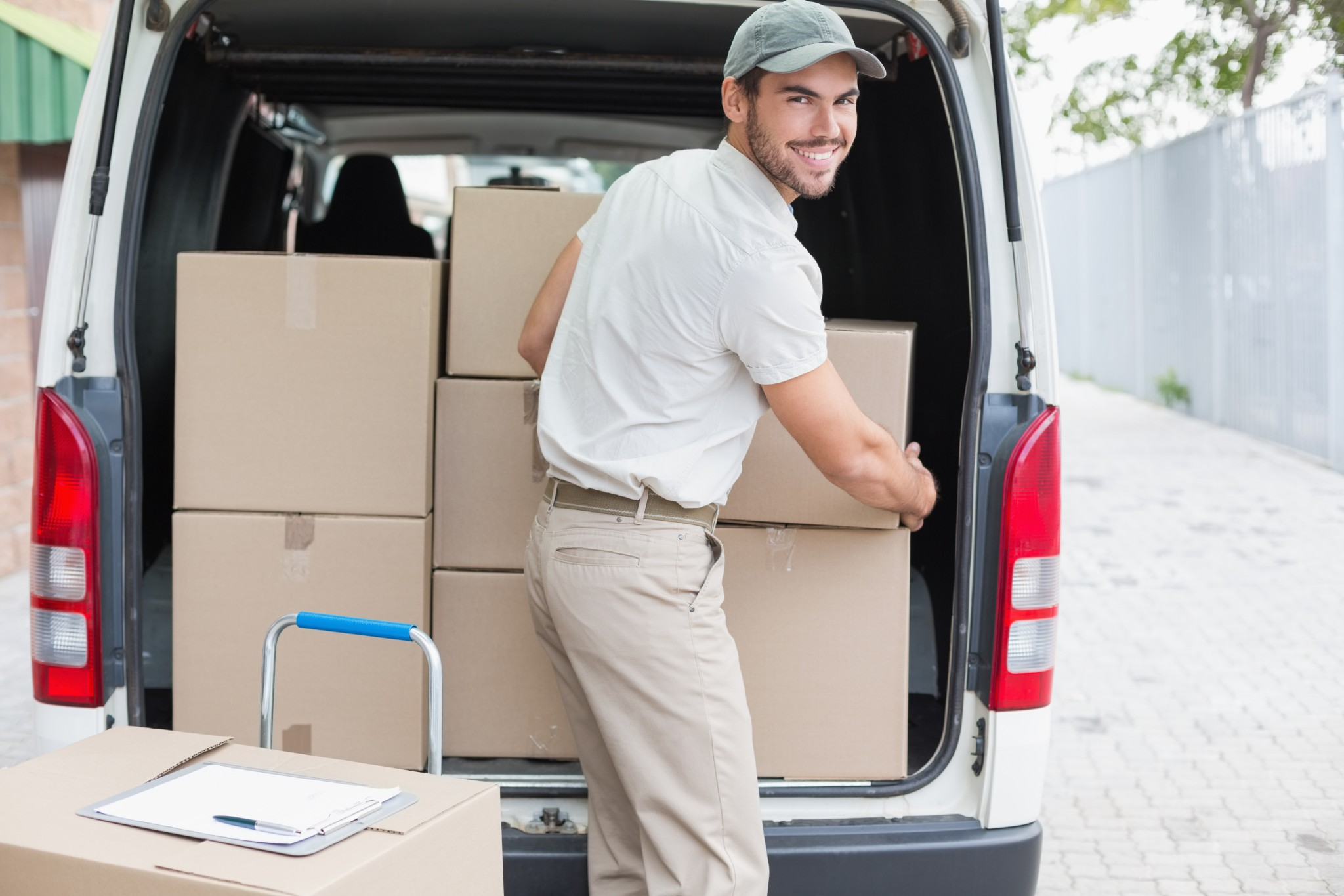 bigstock-Delivery-driver-loading-his-va-71725960